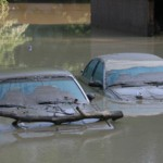 Experts estimate over 200,000 flood-damaged cars are on the road right now.