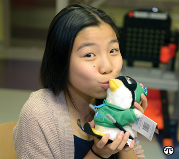 Michelle Nguyen and the adorable holiday duck she designed to help raise money for childhood cancer facilities.