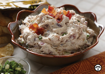 This Creamy Caramelized Onion and Bacon Dip is a crowd-pleaser at any family gathering.