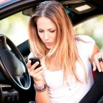 Woman-with-cell-phone-in-carSmall